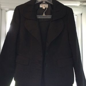 Two piece Black polyester suit .